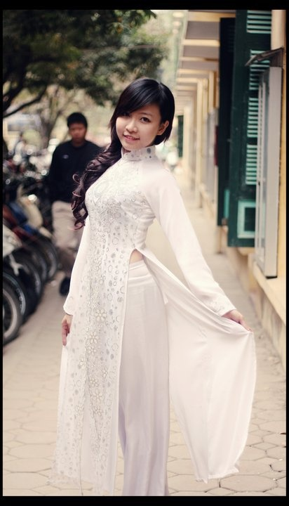 The ao Dai is a Vietnamese dress of a close fitting blouse with long panels in front and back over loose fitting pants.