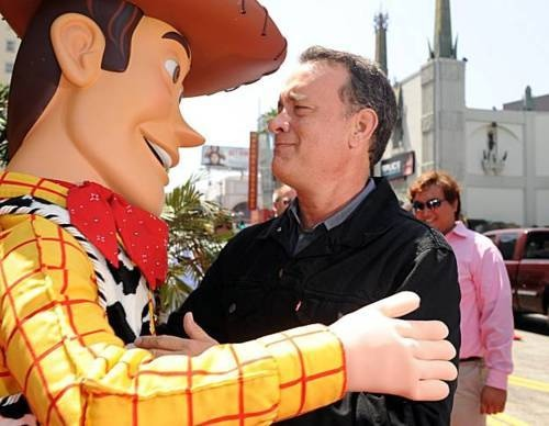 tom hanks and woody =)  awww love this!