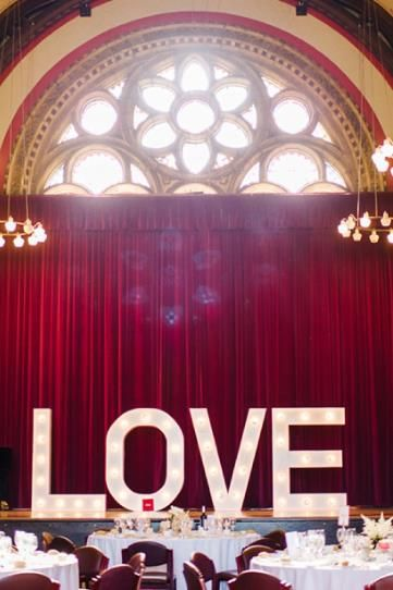 "Love the word ""LOVE"" in lights as dance floor decor."