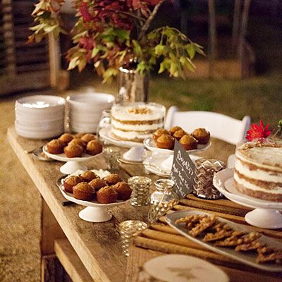 Take cues from fine restaurants and their dessert carts and set up a buffet of sweets nicely arranged on elegant white cakes stands and serving platters.