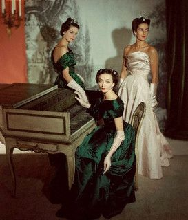 Three women sporting immensely elegant evening wear, 1947. #vintage #fashion #1940s #dress #gown