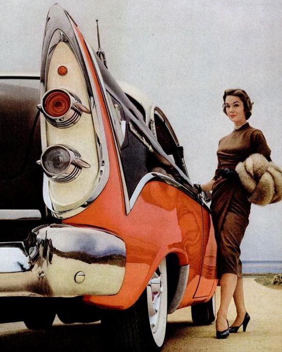 Generously sized orange tail fins and a sophisticated brown dress lend this lovely 1956 car add a subtle autumn vibe. #ad #vintage #car #1950s #orange #fashion #clothing #dress