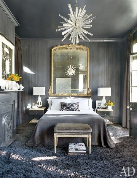 Grey bedroom, gilt mirror over bed
