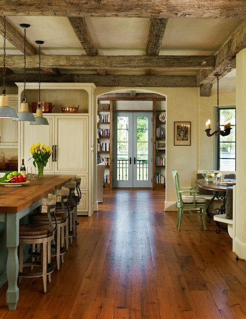 Wide plank wood floor/wooden beams/Barnes Vanze Architects New Country French Cottage