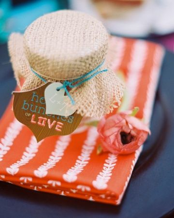 """Burlap-topped favor jars filled with granola and labeled as """"honey bunches of love"""""""