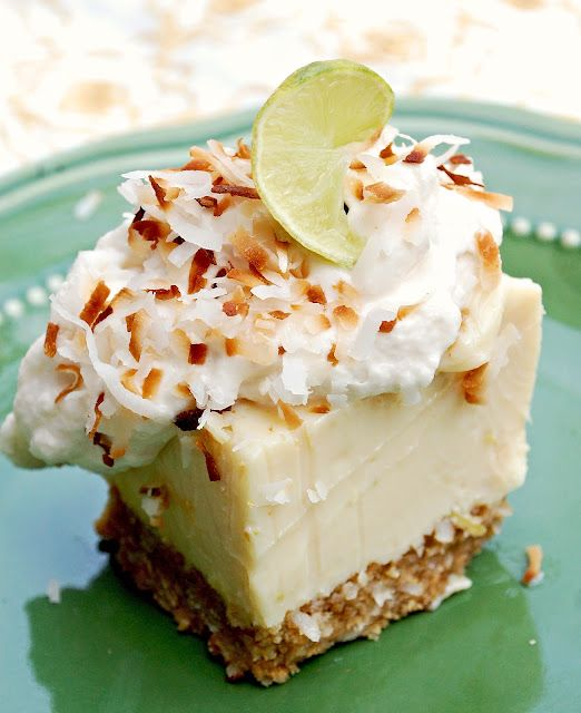 Key Lime Coconut Bars  Crust:  1 1/2 c. graham cracker crumbs (I just buy a container of crumbs so I don't have to bash crackers)  2 T. sugar  1/2 c. sweetened, flaked coconut  1/3 c. melted butter, melted    Filling:  3 cans sweetened, condensed milk  1/2 c. sour cream  3/4 c. key lime juice  1 Tbsp. grated lime zest    Topping:  Whipped cream and toasted coconut for garnish
