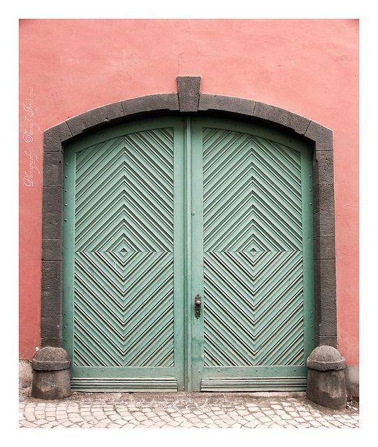 pink walls, turquoise door