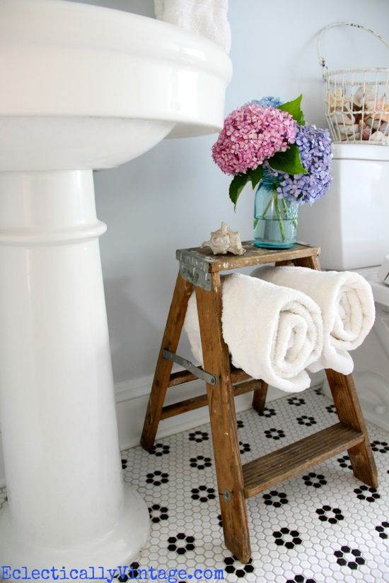 Cute towel storage in this fabulous bathroom!  eclecticallyvinta...