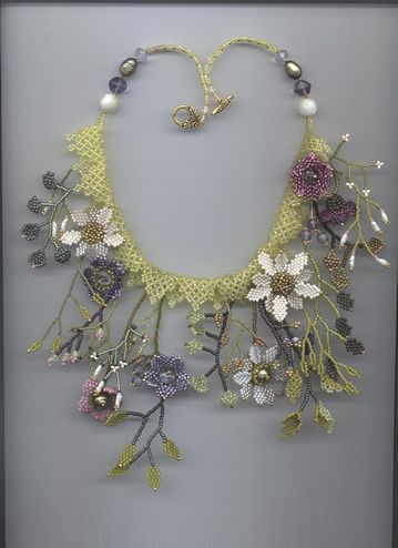 No Tute but a series of absolutely first rate seed bead inspirations.  Site says poppyfield and Margo.  We need more info!