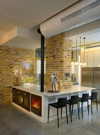 modern kitchen design with bar stools and gas fireplace inserts
