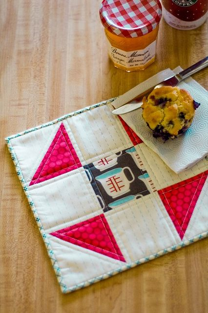 Sweet mug rug features Heidi Kenney Measuring Cup fabric