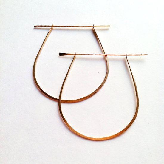 // gold dagger earrings