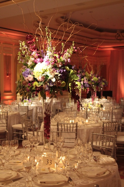 Elevated designs, featuring willow, hydrangea, roses, stock, larkspur, amaranthus, and aggies.