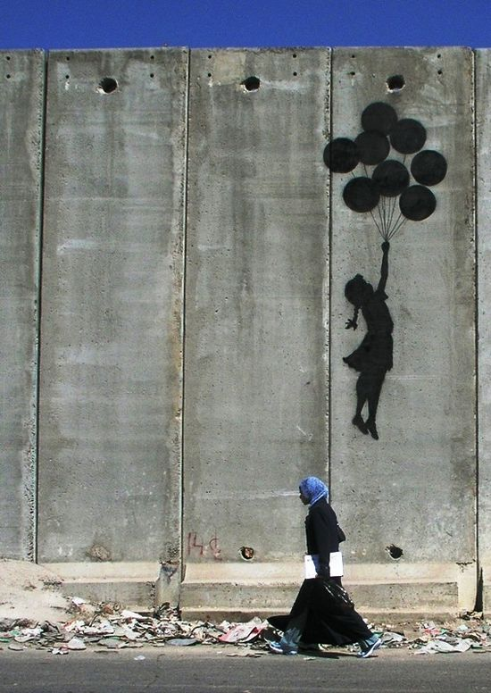 Banksy. Graffiti Mural on the Wall in Palestine (2005)