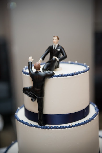 cake topper, one male on top of the cake the other climbing up to him... sweet.