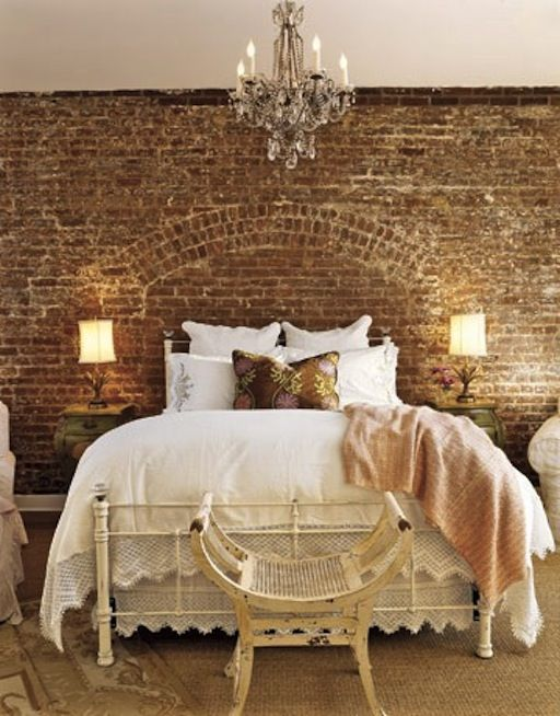 Love this brick wall behind the bed. We're doing this in the house we are building. Great bedding! :)
