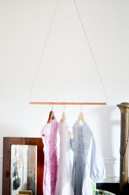 Organize what to wear the day before school with this custom copper metal pipe garment rack. #babiekinsmag