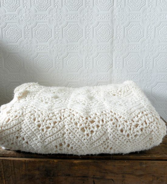 Gorgeous vintage ivory crocheted blanket.