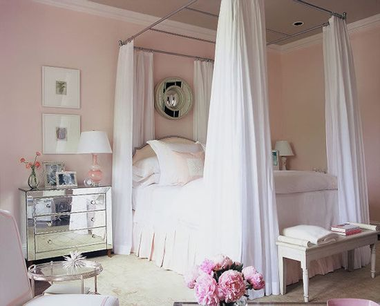 Pink bedroom with the awesome mirror dressers!