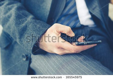 close up of businessman hand typing on smart phone - stock photo BUY IT FROM $1