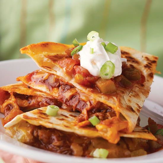Classic quesadillas get a savory update with smoky barbecue sauce. More fast-fix weeknight suppers: www.bhg.com/...