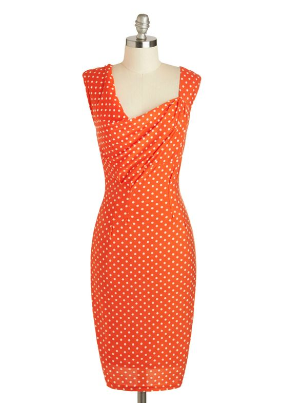 Asymmetrical orange polka dot dress.