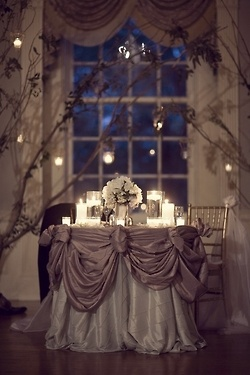 Romantic Table. Kind of reminds me of our table set up/back drop at our wedding