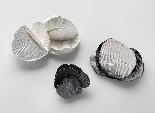 Julie Blyfield  Brooches: Shell Like, Folded Heart-Leaf, Spiral 2013  Oxidised sterling silver, enamel paint