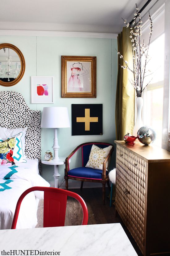 spotted headboard & mixed art