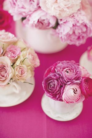 simple pink floral decoration. Would look nice in little groups down a long table or on round tables