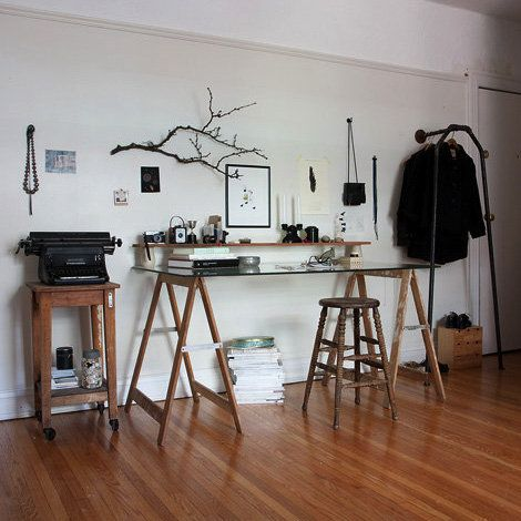 I so love this office space. high drafting table, branch on wall, antique typewriter... etc.