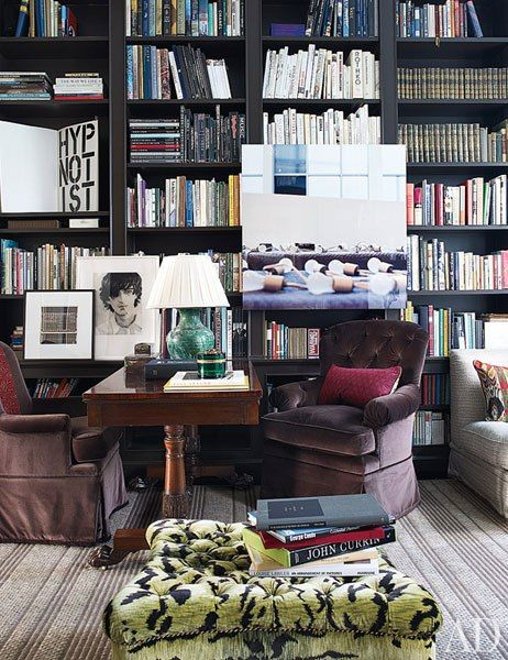 TREY AND JENNY LAIRD'S REVAMPED MANHATTAN BROWNSTONE BY Designer Jeffrey Bilhuber: A Lawler photograph of lightbulbs presides over the library; the desk is 19th-century English.