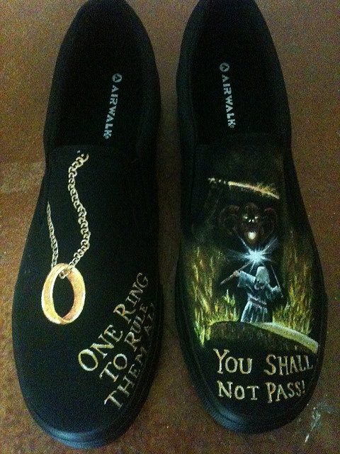 Because LOTR RULES!!!!!  There are also Star Wars shoes on the shop last I checked! So cool!!    Hand Painted Lord of the Rings Shoes by YourSoleExpression on Etsy, $100.00