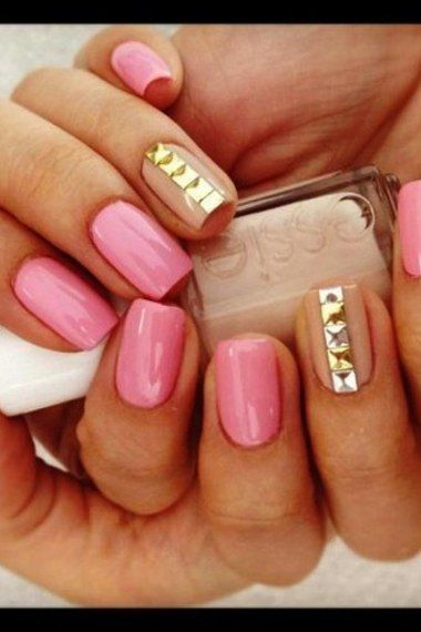 a lovely light pink along a tan polish with beautiful studs!