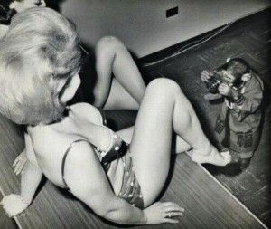 Bikini model photographed by a chimpanzee in a kimono,1963