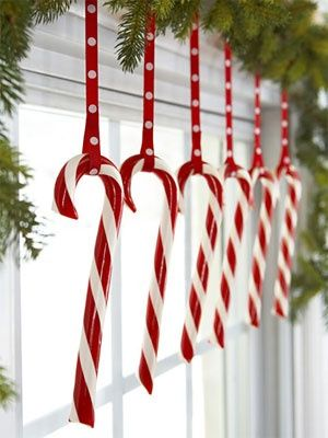Candy canes hooked onto polkadot ribbons liven up a window.