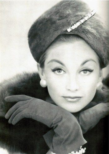 Fur hat, gloves and swooping eyeliner 1950s