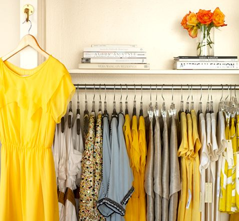 the perfect yellow and gray closet. dresses ~ white books ~ clothes ~ bright & beautiful.