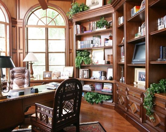 A traditional home office in natural woods and greens.