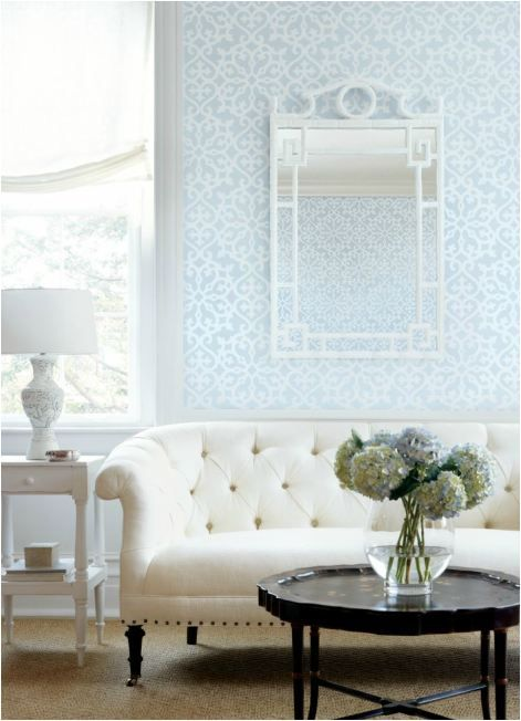 tufted sofa ? + wallpaper by thibaut