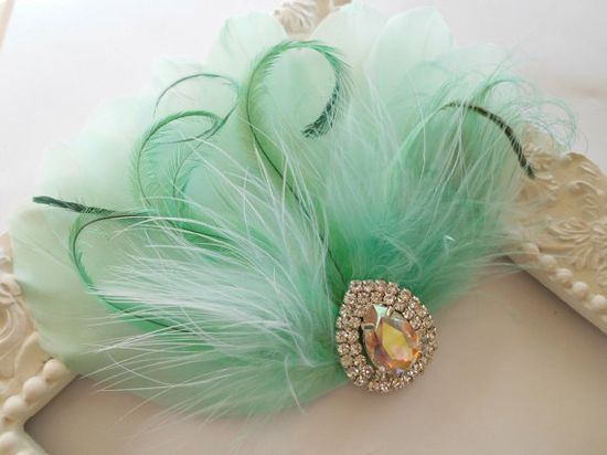 Bridesmaid Bride Feather Hair Accessory Feather by parfaitplumes, $35.00  This feather hair piece blends Mint Nagoire feathers with a beautiful dyed mint peacock plume. The central jewel is encrusted with quality Czech rhinestones that sparkle and flash in the light and a feature pear shaped rhinestone with an Aurora Borealis finish (rainbow colours depending on the light) Accented with a downy soft cluster of Maribou and curled green Emu plumes.