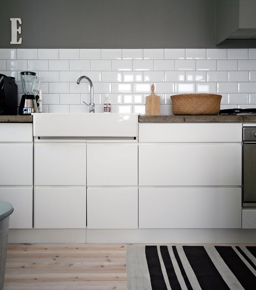 grey walls, white tile. great combination