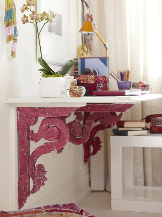 Salvaged Victorian-style porch brackets as a base for a wall-mounted desk by HGTV's Sarah Richardson. Perfect for small spaces!