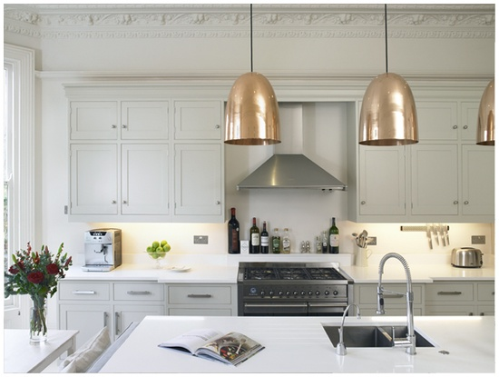 White kitchen + copper lighting