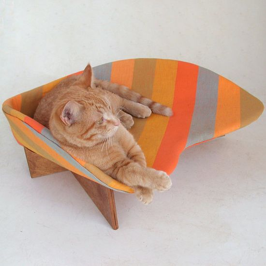 Cat-oriented, dog-friendly lounge features a mod boomerang shape and vintage fabric. Molded of steel mesh that's upholstered and connected to a removable birch plywood base. The bed accommodates any size cat or small #dog. MidCentury Mod Cat Bed in Orange Stripe by likekittysville on #Etsy, $83.00 #cats #design