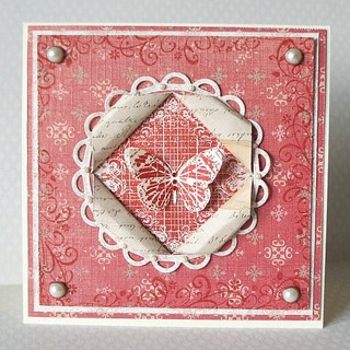 handmade card ... patterned paper ... vintage look in red ... butterfly focus in folded frame ...