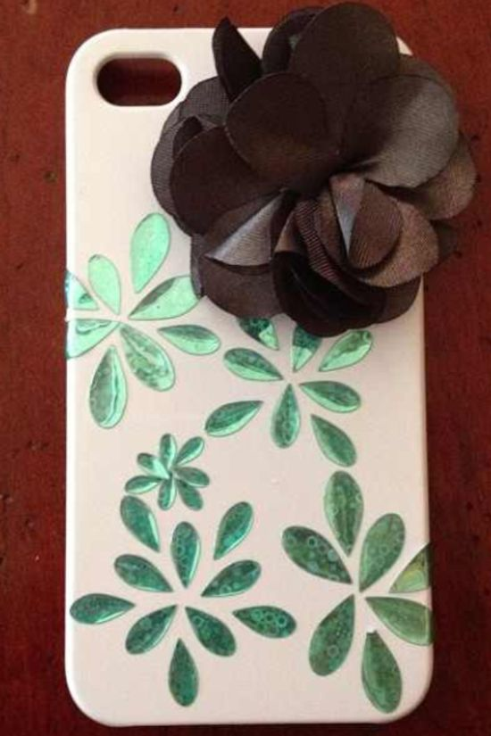 Best phone case ever. It is white and blue with a black flower.