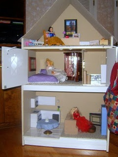 Repurposed Barbie house from old dresser and cardboard