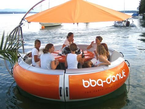 the bbq donut. a party boat, shaped like a donut, made for grilling.