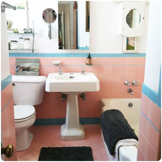 a cute pink and blue bathroom